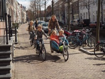 A family cycling on a traffic calmed street