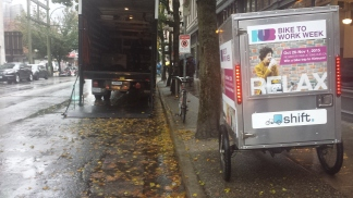The difference in space requirements for a delivery cargo bike opposed to a large delivery truck.