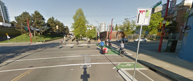 Partially protected intersection Main St and Union St in Vancouver uses concrete islands and phased traffic signals to protect people cycling in the dominant direction of travel.