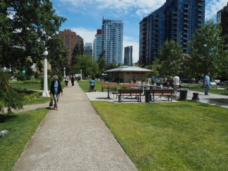 Calgary's Memorial Park does a good job achieving the 10 activities, with a splash park, movable tables and chairs.